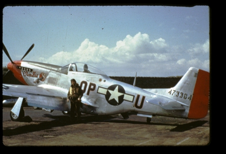 1 Lt. Marvin Arthur standing by his  P-51D Blondie