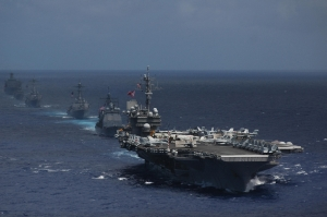4 USS Kitty Hawk (CV 63) and ships from its carrier strike group steam in formation