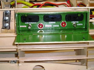 9 Finished Hatch-three switches with charge jacks, gas & oil fill ports & two vents